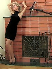 Yummy blondie changing her shiny grey pantyhose for crotchless black ones