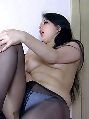 Curvaceous brunette has time to undress her clothes and her black pantyhose