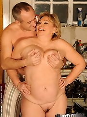 Chubby grandma with giant tits teasing her old slit