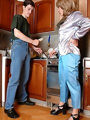 Horny mommy takes young manhood right in the kitchen