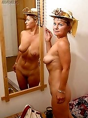 Naked Blonde mature lady in the hat licking her tits