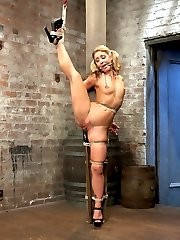 Welcome the amazing Sheena Shaw to her first time here at Kink. We waste no time contorting this flexible tight blonde into outrageous bondage positions. First up, Sheena is suspended in an inverted straddle split suspension. This beautiful girl cums and cums and enjoys the pain and the pleasure of Claire's predicament bondage. In scene two, she is tied in an ebi on a barrel, squirts everywhere in tremendously intense orgasms and is suspended in the air by her neck and ankles. Third, she is bound against a pole with one leg up in the air in standing splits. In the fourth scene, Sheena is bound against the wall in an open legged ball tie. Her nipples are bound to her toes and we get to see orgasm after orgasm squeezed out of this slut with anal and vaginal orgasms.