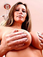 Busty Pandora giving her nipples and clitoris a good pumping