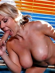Big Tittied Babe Rides a Long Hard Cock