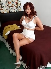 Holly strips to sheer tan nylons and open girdle!