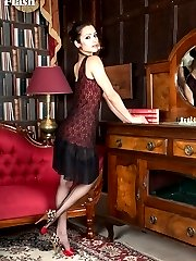 Chelsea teases on the library sofa, showing off her sexy red and black lingerie!