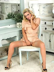 Vanessa strips off her full skirted dress to pose explicitly in extreme heels, French lacy...