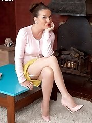 Marlyn in skin tone fully fashioned stockings and bullet bra.