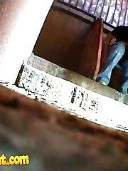 Pissing gal get splattered and filmed in public loo