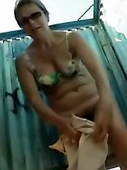 Reallife spy camera flicks representing edible lass undressing in beach cabin