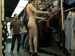 Slut wearing leather in public store