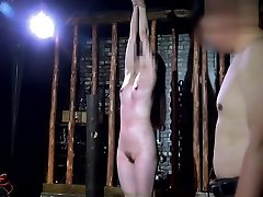 Asian Bombshell in BDSM Dungeon
