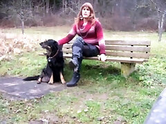 She-male sitting on Parkbench near road