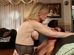 Blonde MILF disrobes for young dude who sucks her hard nipples
