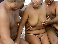 Time worn granny is getting finger plumbed in filthy MMF threesome