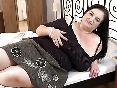 Mature fatty with big Tits spreads her gams young man