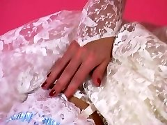 An Softcore Taunt 001-A Brunette Hair Bride Takes Off Out of Her Suit