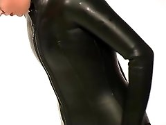 Dressing in beavertail wetsuit & knee boots, wearing black latex catsuit