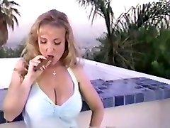 Danni ashe smoking a cigar