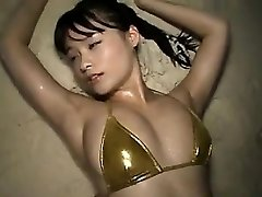 Oriental Babe At The Beach In A Bikini Softcore