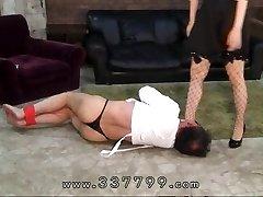 Japanese femdom slaves dick in sexy wax.