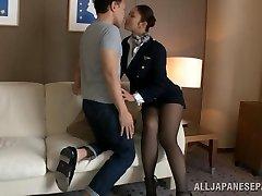 Sexy stewardess is an Oriental doll in high heels