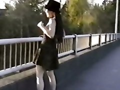 Oriental hotty flashes tits from bridge