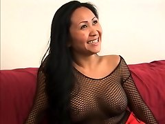 Guy receives a foot job from a cute asian in fishnets