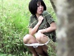 Asian ho pees outdoors