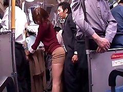 Japanese slut sucks pecker in a public bus