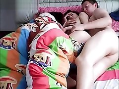 Chinese husband cheating on wifey while she is sleeping.