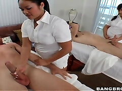 Two professional masseurs Ashley Marie and Marquetta Love Button give a great stiffy massage