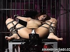 Luxurious girl is tied up and poked by big machine