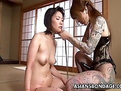 Tattooed up Asian mistress strap on fucking the marionette