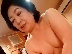 Asian grannie give the handjob