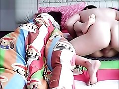 Asian spouse cheating on wife while she is sleeping.