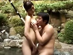 Breasty bitch fucking an Asian guy in a pool