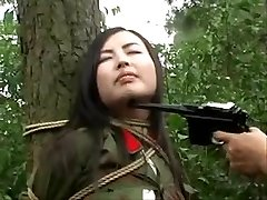 Chinese army gal tied to tree 1