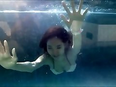 Young Asian Girl in Handsome Bikini at a Swimming Pool