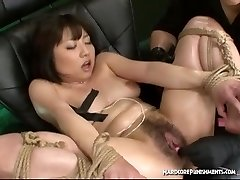 Sexy Asian women tied down and brought to climax with vibrating sex toys