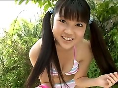Super-cute Korean college schoolgirl poses in bikini in the garden