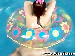 Oriental sex doll porked in pool by holder