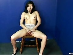 Magnificent Asian babe rubbing on her wet pussy