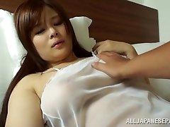 Japanese AV Model is a hot milf in semi-transparent lingerie