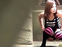 Japanese slut urinate squats