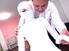 Subtitled bizarre Asian female bandaged head to toe