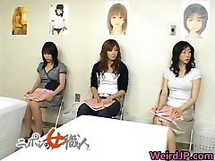 Asian wife is inspecting female workers