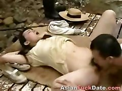 Horny Chinese spouse and wife duo get playful in the woods