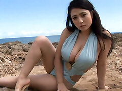 Sporty Japanese sweetie Nonami Takizawa demonstrates off her saucy tits on webcam outdoors