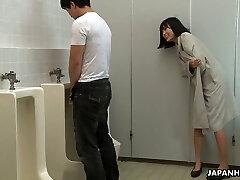 Crazy Asian woman Uta Kohaku pisses on dick of one stranger dude in a public rest room